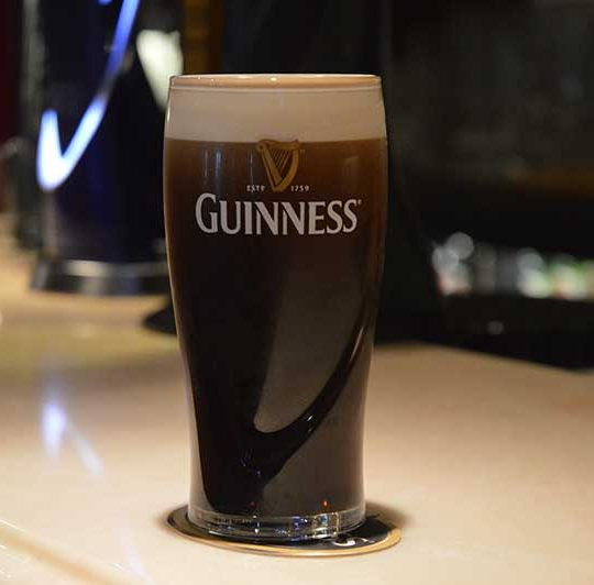 A pint of Guinness getting ready to be enjoyed at Magherabuoy House