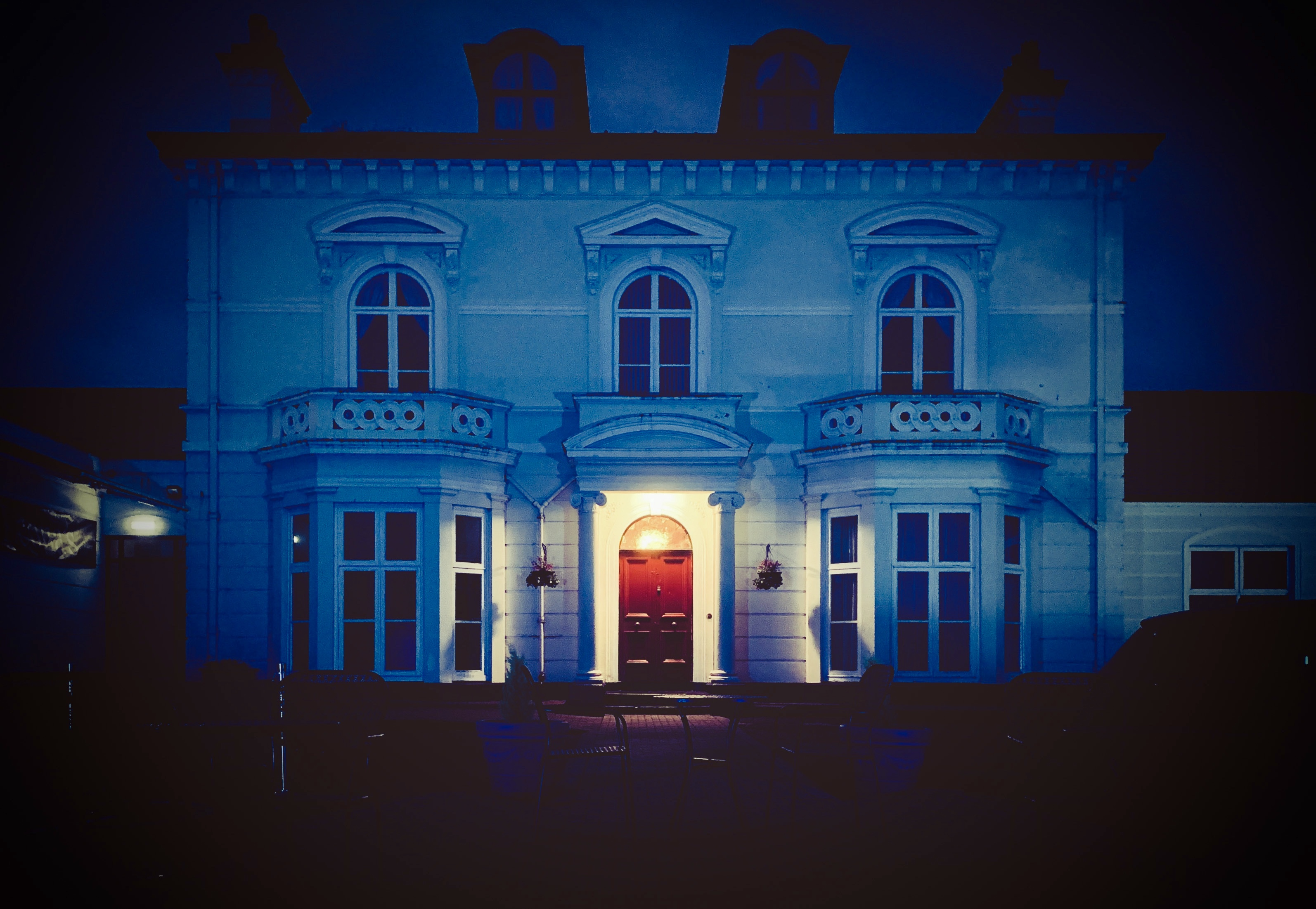 Magherabuoy House lit up blue in honour of the NHS